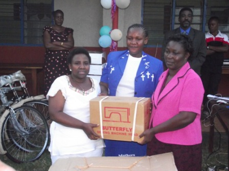 Mothers Union Leaders receiving treadle sewing machines