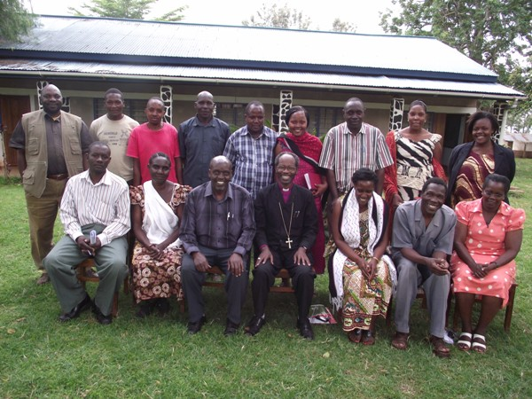 Bishop Mwita with staff of Mogabiri Farm Extension Centre, after meeting