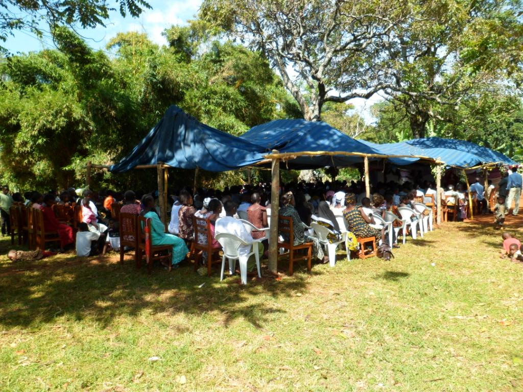 congregation at mogabiri church worshipping outside during confirmation service in july 2012